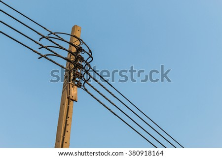 electricity post with clear blue sky