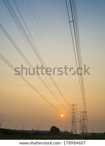 Electricity power line and pylons at sunset