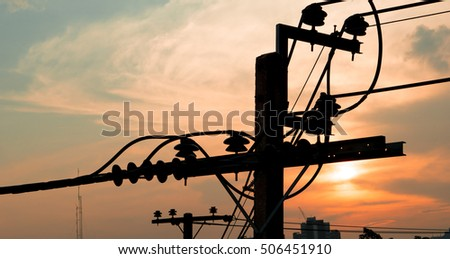 Electricity power plant and city concept - Electric pole in city with evening light and space for text