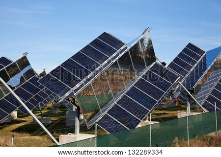 Electricity production at solar cells farm - stock photo