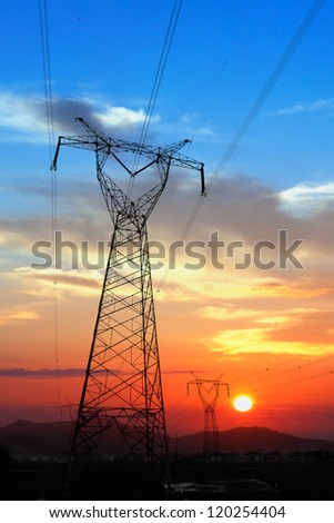 Electricity Pylon at amazing colorful of sunset - stock photo