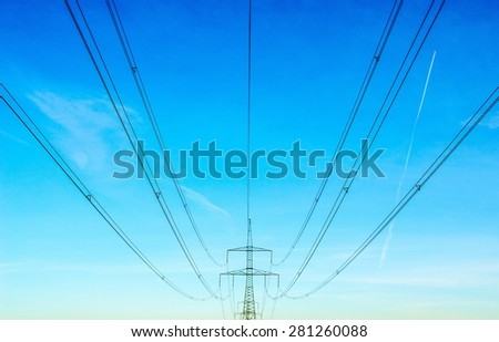 Electricity pylon at sunshine and blue skies