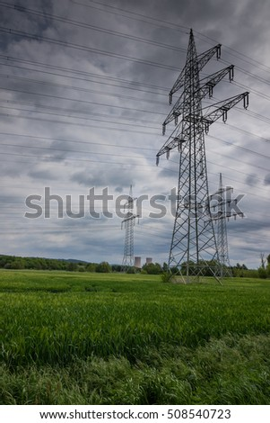 Electricity pylon in the field, Germany .