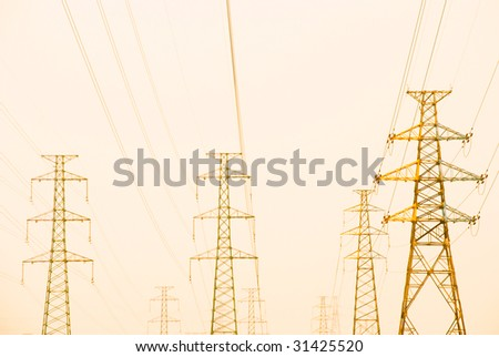 Electricity pylon iron grid with power lines.