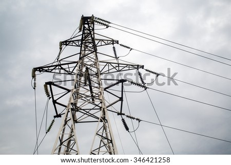 Electricity pylon on a background cloudy sky. High voltage tower.