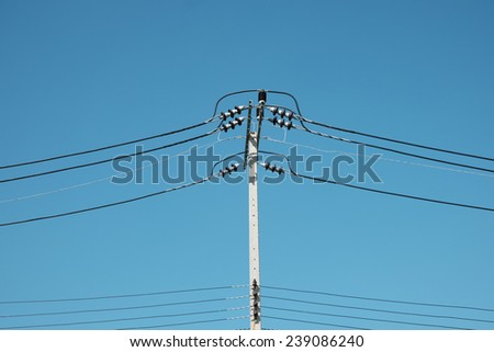 Electricity pylon on blue sky - stock photo