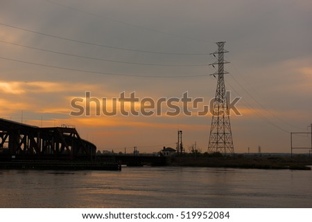 Electricity pylon on the banks of a river