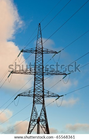 Electricity pylon over blue sky and few clouds