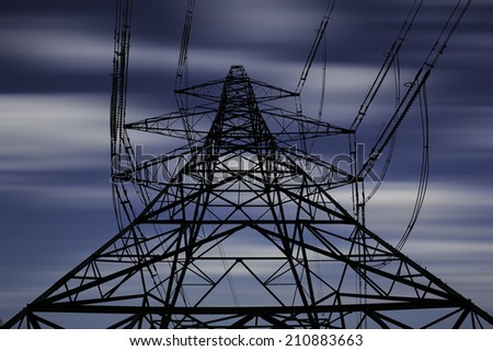 Electricity pylon with long exposure sky