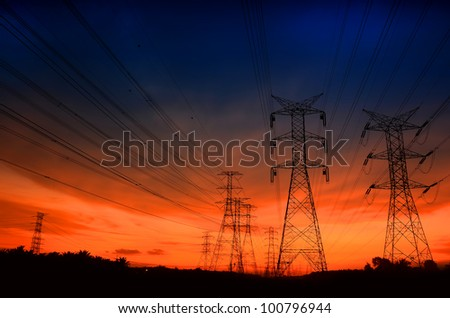 Electricity pylons and amazing dark color of sunset - stock photo