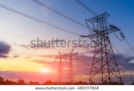 Electricity pylons and lines beautiful sky and the sunset over the horizon