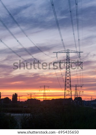 Electricity pylons in the Netherlands during sunset