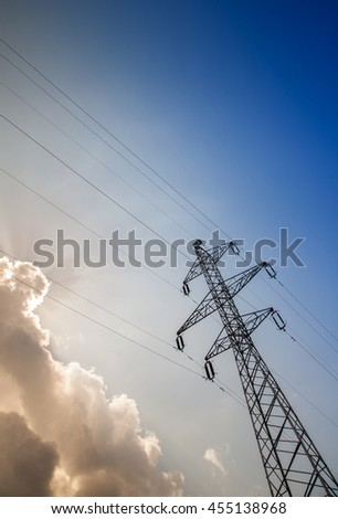 Electricity pylons with blue sky background