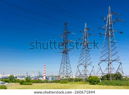Electricity pylons with blue sky on the background - stock photo