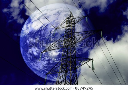 Electricity pylons with with planet earth. - stock photo