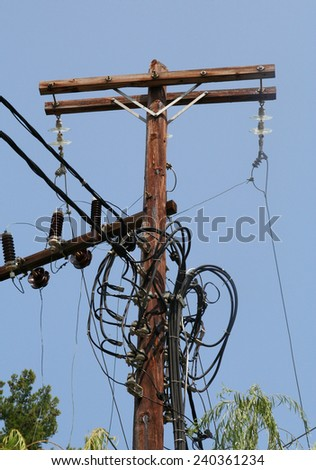 Electricity supply on the Greek Island of Skopelos. Tangle of wires, seemingly disorganised and raises questions of health and safety with reliability. - stock photo