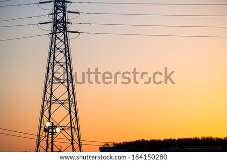 Electricity tower and lines at sunset