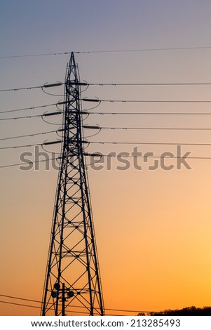 Electricity tower and lines at sunset sky, Japan