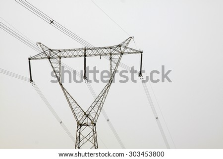 Electricity tower in the sky, closeup of photo  - stock photo