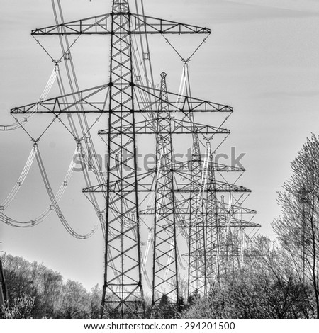 Electricity towers in landscape  - stock photo