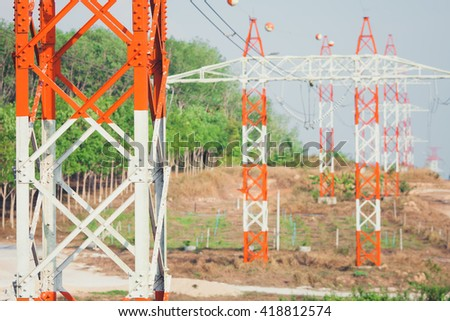 Electricity transmission power lines (High voltage tower).Vintage tone - stock photo