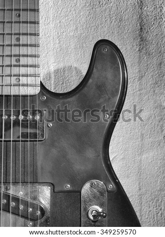 Electro guitar on background of old wall      - stock photo