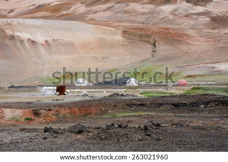 Electro station moduls and pipes among lava fields and hills near Myvatn lake in North Iceland - stock photo