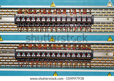 Electromagnetic relays are located on the same line in a series - stock photo