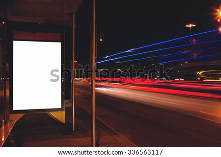 Electronic advertising board with copy space screen for your text message or content, empty banner in urban setting, clear poster with night light on background, public information billboard outdoors