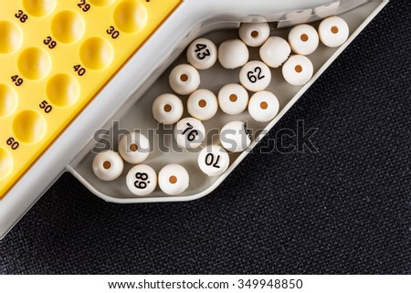 Electronic bingo game with balls to play. Horizontal image viewed from above. - stock photo