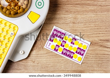 Electronic bingo game with cards and chips to play. Horizontal image viewed from above. - stock photo