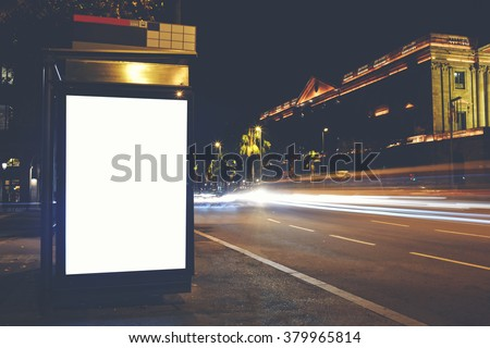 Electronic blank billboard with copy space for your advertising text message or content, public information board in night town,promotional mock up in urban scene, empty Light-box in metropolitan city - stock photo