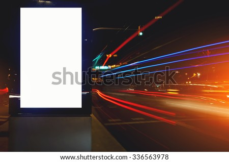 Electronic blank billboard with copy space for your text message or promotional content, public information board in night city with the movement cars on background, clear advertising mock outdoors  - stock photo