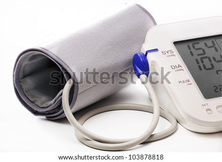 Electronic blood pressure meter and cuff. Meter display showing high blood pressure 154/104