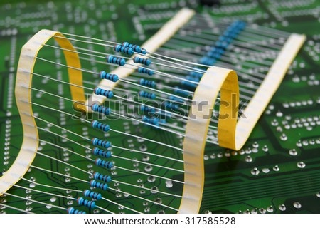 Electronic board circuit with resistors  - stock photo