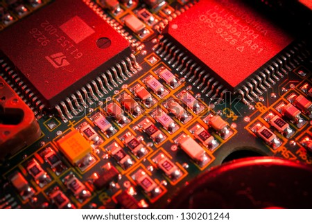 electronic board toned red - stock photo