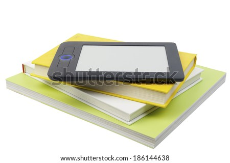 Electronic book reader on top of books - stock photo