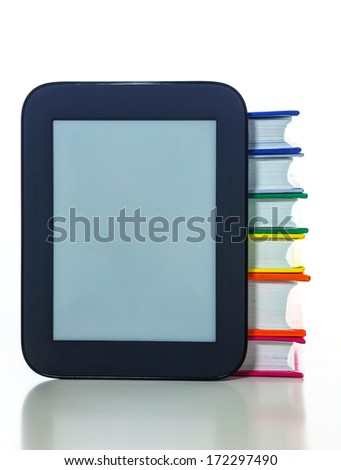 Electronic book reader with a pile of hard cover books - stock photo