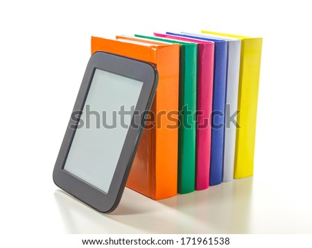 Electronic book reader with a row of hard cover books - stock photo