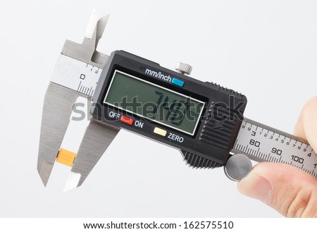 Electronic caliper measure yellow capacitor