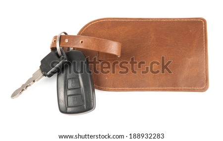 Electronic car key and its keyring with leather, isolated over white background