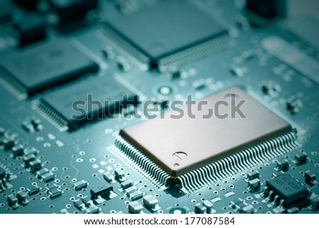Electronic chips mounted on motherboard - stock photo