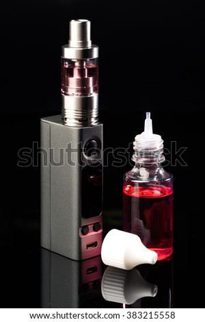 Electronic Cigarette and liquid on black background