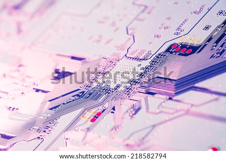 Electronic circuit board close up. - stock photo
