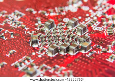 Electronic circuit board close up. Red PCB - stock photo