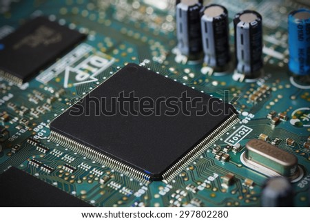 Electronic circuit board, microchip integrated on motherboard - stock photo