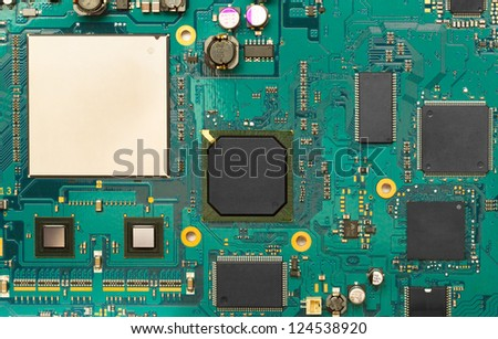 electronic circuit board with components - stock photo