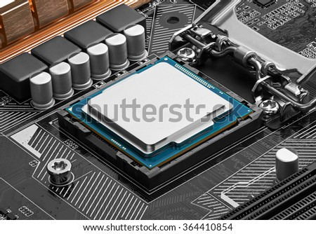 Electronic circuit board with processor, close up. - stock photo