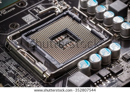 Electronic circuit board with processor socket - stock photo