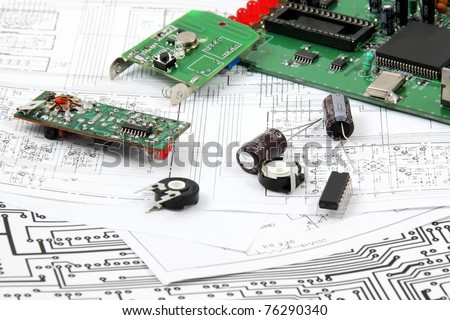 Electronic circuit boards on the background of electronic scheme - stock photo